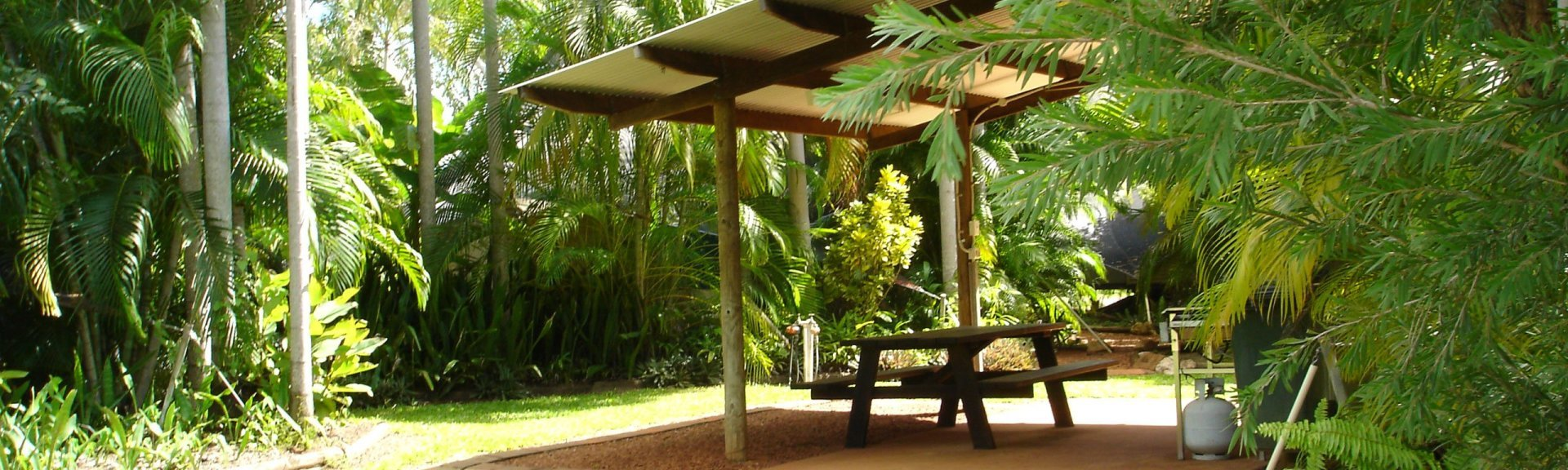 A shady picnic spot at Anbinik Resort. Photo by Anbinik Resort