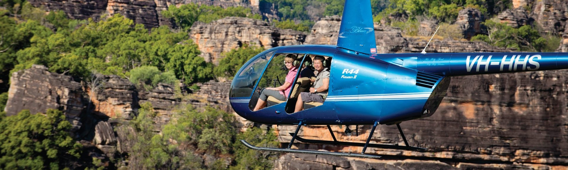 Passengers in a helicopter over Kakadu's escarpments. Photo by Tourism NT.