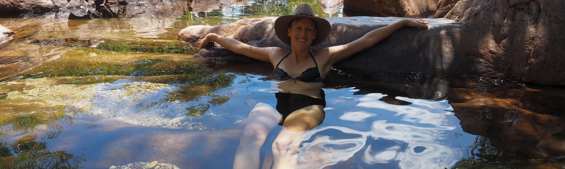 Visitor relaxing in the water at Kakadu National Park. Image credit Charter North 4WD.