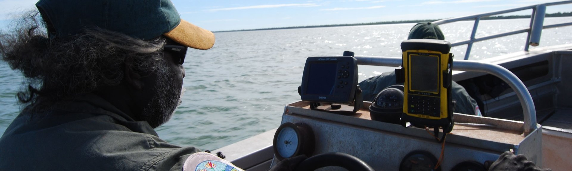 Indigenous ranger on a boat. Project Djelk.