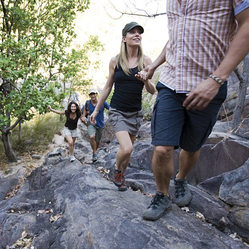 Visitors walking up the path to Gunlom Falls. Credit Tourism NT