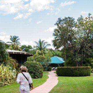 Visitor walking in gardens of Aurora Kakadu