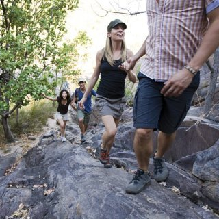 Visitors walking up the path to Gunlom Falls. Photo: Tourism NT