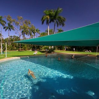 Visitors in Kakadu Lodge swimming pool and gardens. Photo: Kakadu Lodge