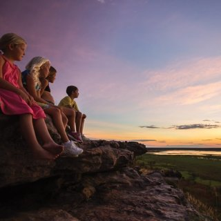 Children watch the sunset at Ubirr