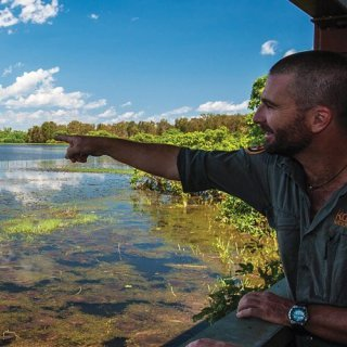Ranger pointing out birds on the wetlands