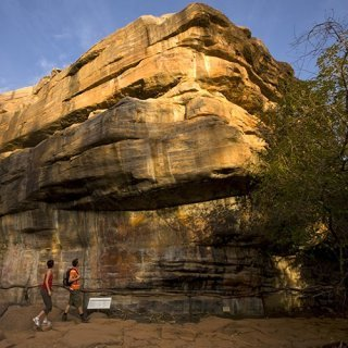 Visitors viewing rock art at Ubirr. Photo: Peter Eve