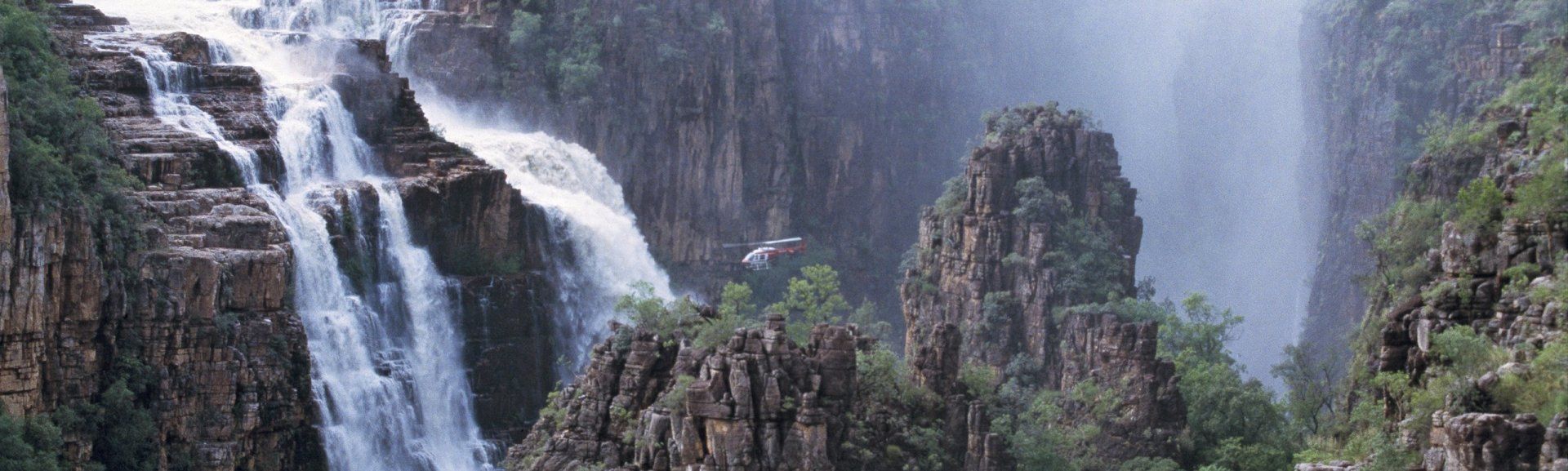 Helicopter over Twin Falls. Photo: Tourism NT