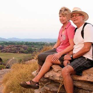 Bushwalkers sitting at Ubirr Lookout. Photo by Tourism NT