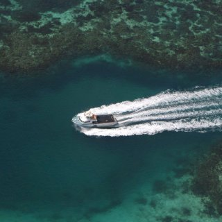 A boat cruising near the Houtman Abrolhos Islands (Easter Group) off the coast of Western Australia.