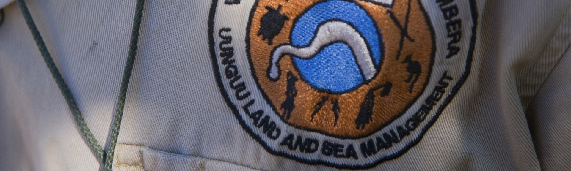 Close up of a Wuunambal Gaambera Uunguu Land and Sea Management ranger badge. Photo: Dragi Markovic