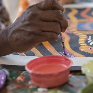 Dot painting with Maruku Arts. Photo: Tourism NT