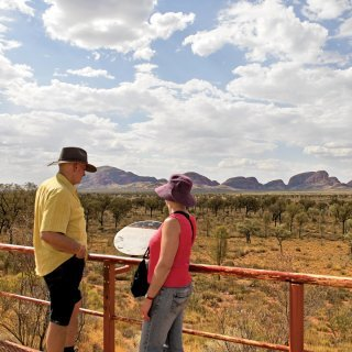 Couple admiring Kata Tjuta from the dune viewing area