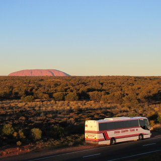 Tour coach near Uluru. Photo: All Australian Journeys