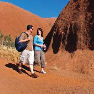 Walkers at Uluru. Photo: Tourism Australia