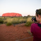 Taking a snap at Uluru. Photo: Groovy Grape Tours