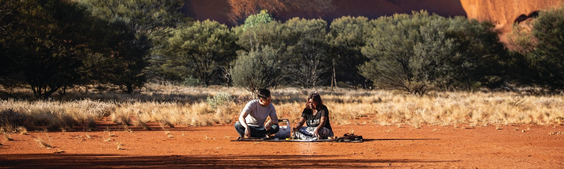 Dot painting with Maruku Arts. Photo: Tourism Australia