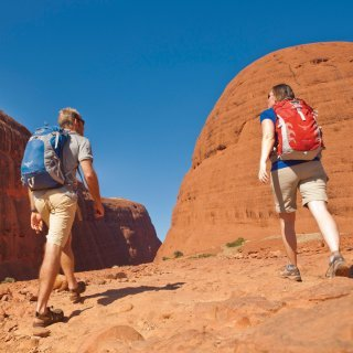 Couple walking at Kata Tjuta. Photo: Tourism NT